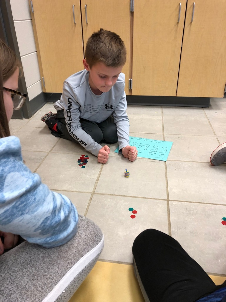 A student plays the dreidel game
