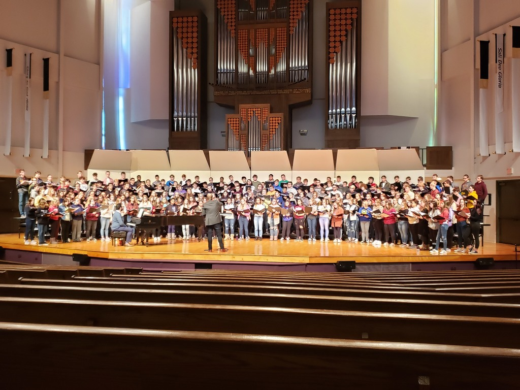 Students singing at BJ Haan Auditorium- Dordt University