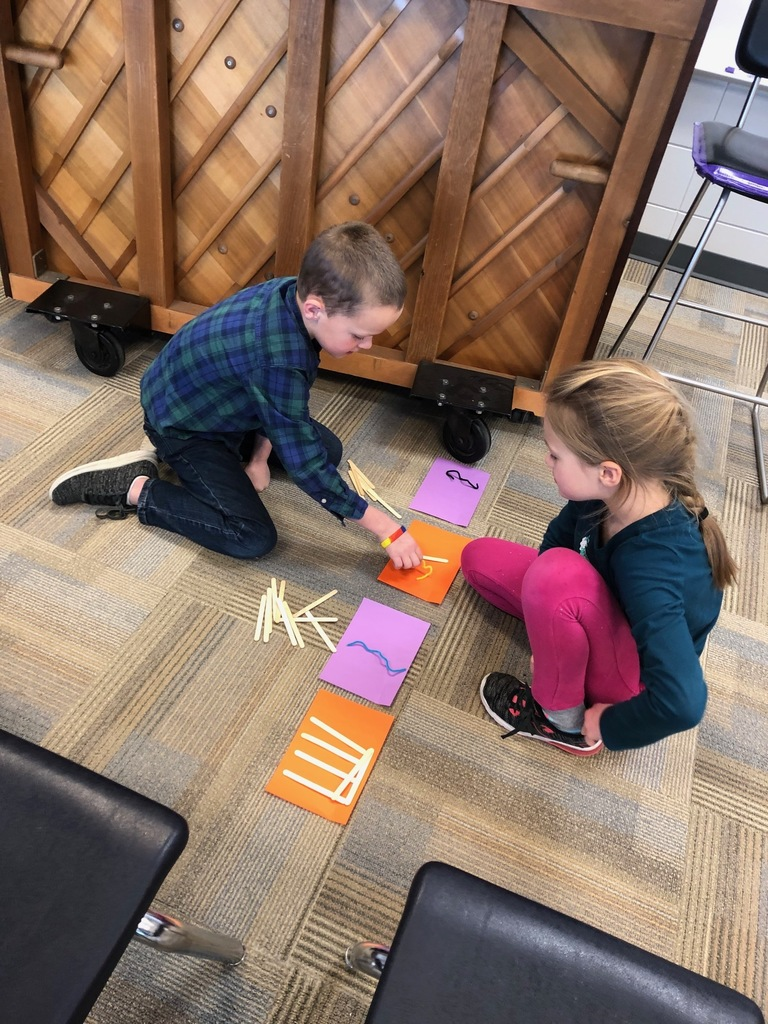 Students use popsicle sticks to compose rhythms