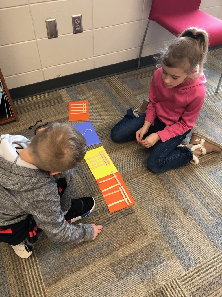 Students compose rhythms with popsicle sticks